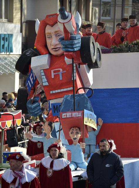 A carnival float depicts Russia's president Putin as a robot out of control named Putinator, during the traditional carnival parade in Cologne, western Germany, Monday, February 16, 2015. (Photo by Martin Meissner/AP Photo)