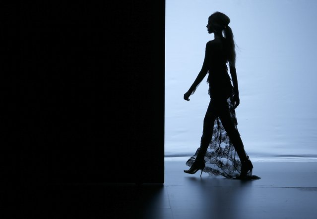 A model is silhouetted presenting a creation from Juana Martin's Fall/Winter 2015 collection, during the Mercedes-Benz Fashion Week in Madrid, February 8, 2015. (Photo by Javier Barbancho/Reuters)