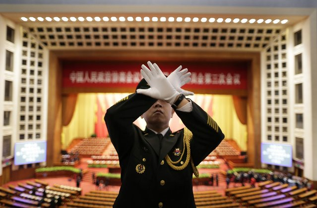 A military band conductor practises during a rehearsal ahead of the opening session of Chinese People's Political Consultative Conference (CPPCC) at the Great Hall of the People in Beijing March 3, 2015. REUTERS/Jason Lee