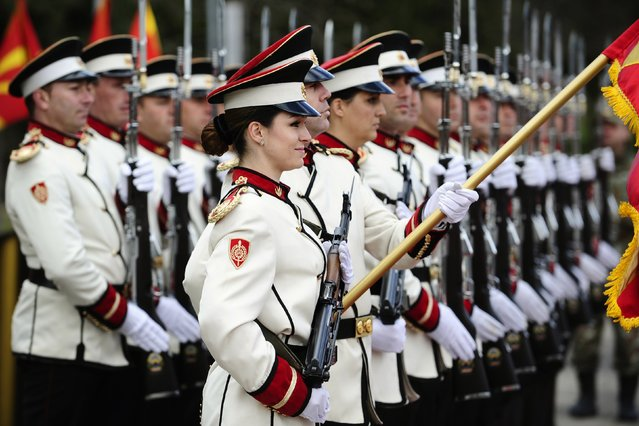 Corporals Drakana Kitanovska (front L) and Verica Zlatevska (front 3rd L) attend an honour guard training session at an army barracks in Skopje March 4, 2015. Macedonia's honour army battalion, the ceremonial uniformed guard that receives every foreign president, dignitaries and delegations, but also sees off and welcomes the head of state every time he leaves the country, has a different glow. For the first time in the history of Macedonia's army, the honour guard has two women in its ranks. There has not been an event in which one of them is not in the first row. Zlatevska joined the army in 2003, Kitanovska in 2006. Picture taken March 4, 2015.   REUTERS/Ognen Teofilovski (MACEDONIA - Tags: MILITARY SOCIETY)