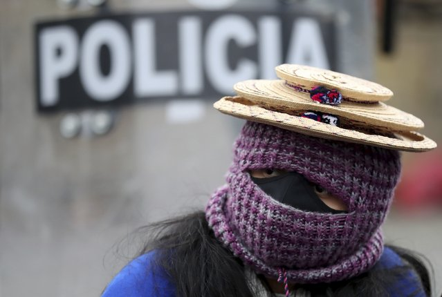 A Misak Indigenous woman takes part in an anti-government protest triggered by proposed tax increases on public services, fuel, wages and pensions, in Bogota, Colombia, Wednesday, June 9, 2021. (Photo by Fernando Vergara/AP Photo)