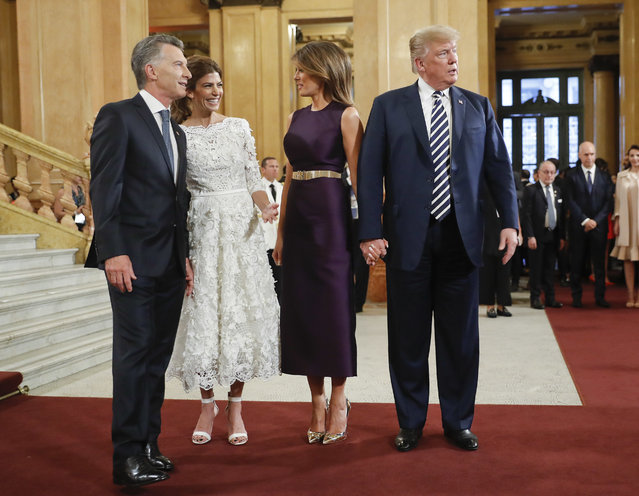 President Donald Trump and first lady Melania Trump talk with Argentina's President Mauricio Macri and his wife Juliana Awada as they arrive at the Teatro Colon to join other heads of state for the G20 leaders dinner, Friday, November 30, 2018 in Buenos Aires, Argentina. (Photo by Pablo Martinez Monsivais/AP Photo)