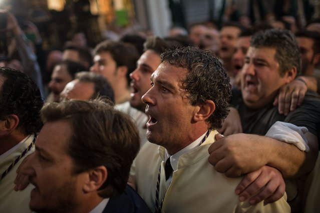 Antonio Banderas sings to Maria Santisima de Lagrimas y Favores trone with his mates prior to start its procession at San Juan Bautista church during Holy Week celebrations on March 29, 2015 in Malaga, Spain.  (Photo by Gonzalo Arroyo Moreno/Getty Images)