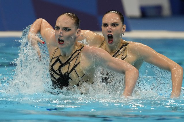 Svetlana Kolesnichenko and Svetlana Romashina of Russian Olympic Committee compete in the Duet Free Routine Preliminary at the Tokyo Aquatics Centre at the 2020 Summer Olympics, Monday, August 2, 2021, in Tokyo, Japan. (Photo by Dmitri Lovetsky/AP Photo)