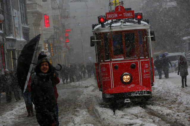 A vintage tram runs along the main shopping and pedestrian street of Istiklal during a snowfall in central Istanbul, Turkey January 7, 2017. (Photo by Murad Sezer/Reuters)