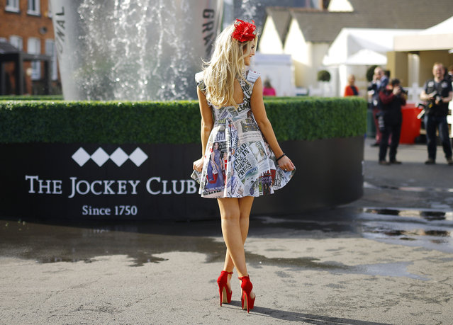 Horse Racing – Crabbie's Grand National Festival – Aintree Racecourse April 10, 2015: Racegoer poses wearing a newspaper print dress on ladies day during the Grand National. (Photo by Darren Staples/Reuters)