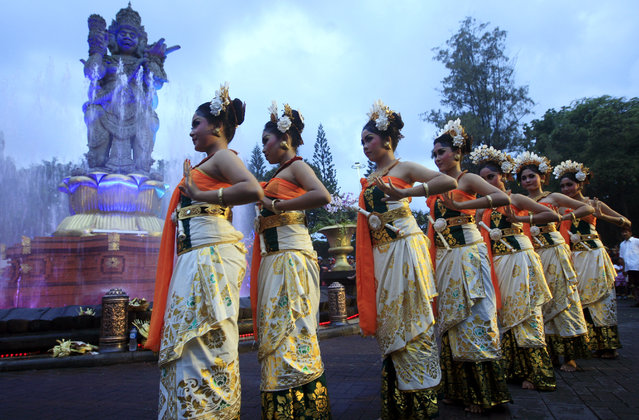 Balinese girls in traditional costumes dance during a parade for this year's last sundown in Bali island, Indonesia on New Year's Eve, Tuesday, December 31, 2013. (Photo by Firdia Lisnawati/AP Photo)