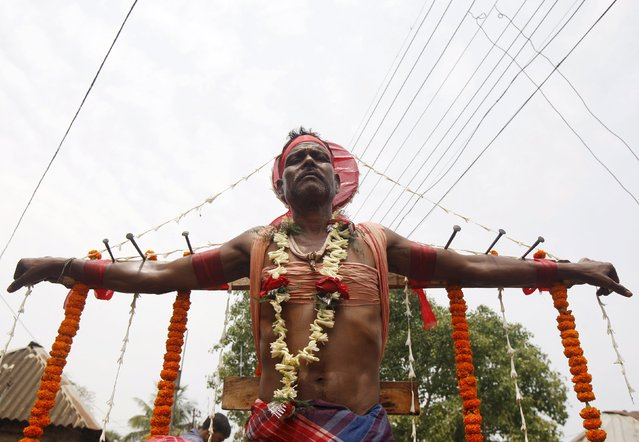 A Hindu devotee is seen nailed to a cross during the annual Shiva Gajan religious festival in Batanal village, east of Kolkata, April 14, 2015. (Photo by Rupak De Chowdhuri/Reuters)