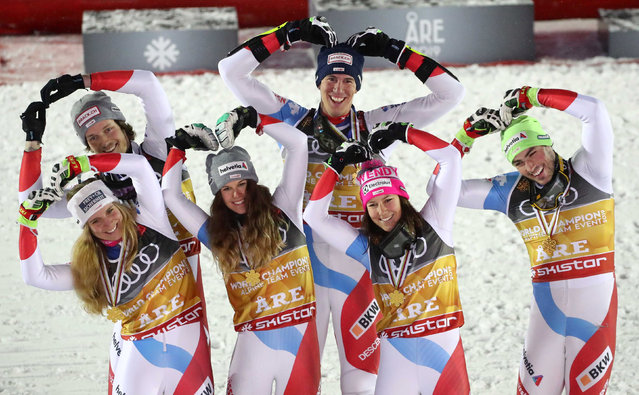 Winner Swiss team (Aline Danioth, Andrea Ellenberger, Wendy Holdener, Sandro Simonet, Daniel Yule and Ramon Zenhaeusern) celebrate with their medals after the Alpine team event at the 2019 FIS Alpine Ski World Championships at the National Arena in Are, Sweden, on February 12, 2019. (Photo by Denis Balibouse/Reuters)