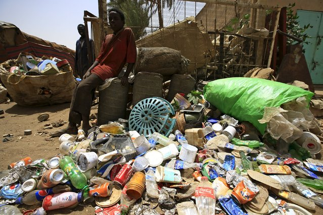 Boys wait next to plastic materials they brought to a recycling station in Khartoum North April 16, 2015. (Photo by Mohamed Nureldin Abdallah/Reuters)