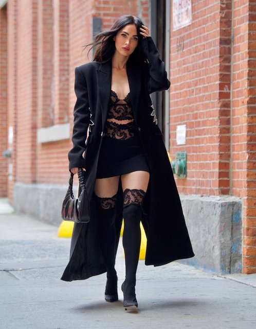 Megan Fox stuns in a lace crop top and matching stockings in Manhattan, New York as she strolled to a business meeting on September 12, 2021. (Photo by Rex Features/Shutterstock)