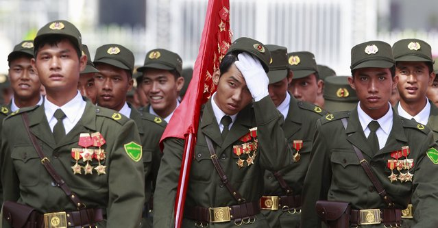 Vietnamese village policemen walk in front of the Unification Palace (formerly Presidential Palace) after a rehearsal for a military parade as part of the 40th anniversary of the fall of Saigon in southern Ho Chi Minh City (formerly Saigon City), Vietnam, on April 26, 2015. (Photo by Reuters/Kham)