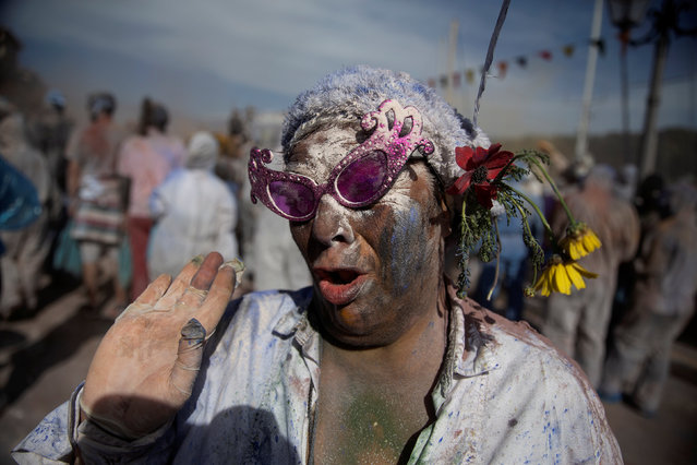 "A reveller celebrates ""Ash Monday"" by participating in a colourful ""flour war"", a traditional festivity marking the end of the carnival season and the start of the 40-day Lent period until the Orthodox Easter, in the port town of Galaxidi, Greece, March 11, 2019. (Photo by Alkis Konstantinidis/Reuters)"