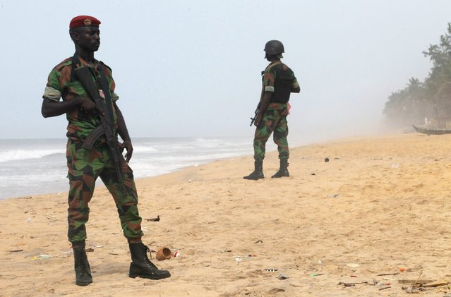 Soldiers stand guard on the beach following an attack by gunmen from al Qaeda's North African branch, in Grand Bassam, Ivory Coast, March 14, 2016. (Photo by Luc Gnago/Reuters)