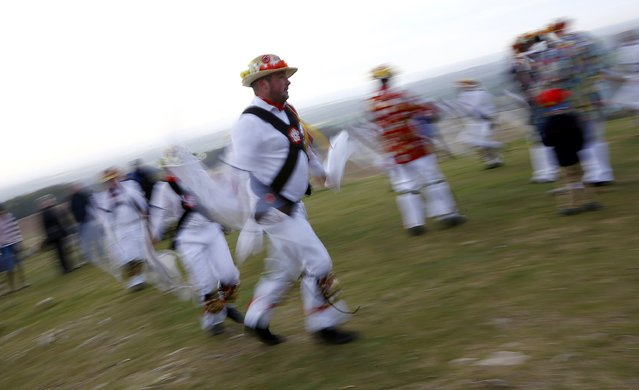 Leicester Morrismen dance during May Day celebrations at Bradgate Park in Newtown Linford, Britain May 1, 2015. (Photo by Darren Staples/Reuters)