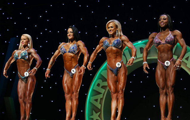 Bodybuilding entrants in the future section pose at the Arnold Classic Pro Show held in Melbourne, Australia, 18 March 2016. The Arnold Classic is a bodybuilding competition held over three days in Melbourne. (Photo by David Crosling/EPA)