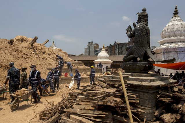 Nepal military personnel clear the debris inside a compound of Vishnu temple, after the earthquake in Kathmandu, Nepal, May 6, 2015. (Photo by Athit Perawongmetha/Reuters)