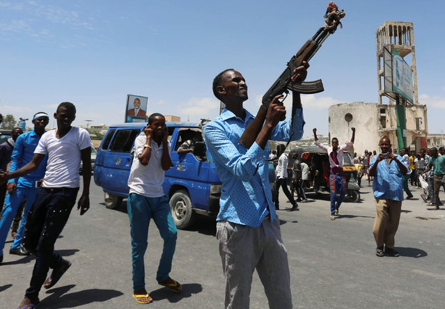 A civilian prepares to shoot in the air as people celebrate the election of President Mohamed Abdullahi Mohamed in the streets of Somalia's capital Mogadishu, February 9, 2017. (Photo by Feisal Omar/Reuters)