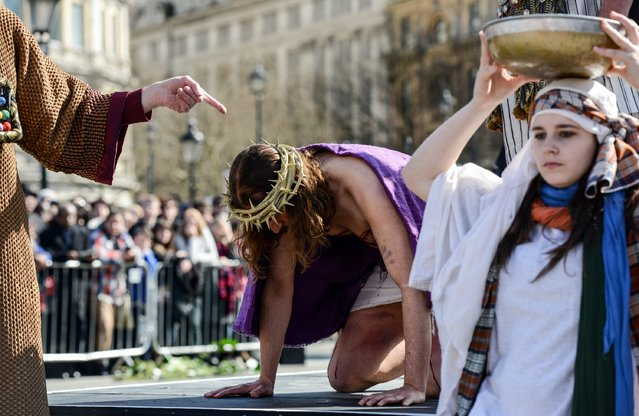 "Actor James Burke-Dunsmore is mocked before having to carry a crucifix whilst playing Jesus during The Wintershall's ""The Passion of Jesus"" in front of crowds on Good Friday at Trafalgar Square on March 25, 2016 in London, England. (Photo by Chris Ratcliffe/Getty Images)"