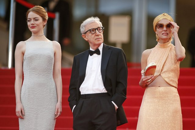 "Director Woody Allen (C), cast members Emma Stone (L) and Parker Posey pose on the red carpet as tey arrive for the screening of the film ""Irrational Man"" out of competition at the 68th Cannes Film Festival in Cannes, southern France, May 15, 2015. (Photo by Benoit Tessier/Reuters)"