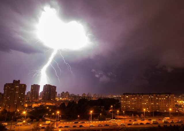 A lightning strikes are seen during a thunderstorm over the city of Minsk, Belarus, August 14, 2018. (Photo by Vasily Fedosenko/Reuters)