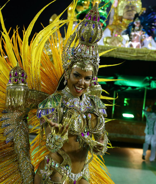 A reveller from Mocidade samba school performs during the second night of the carnival parade at the Sambadrome in Rio de Janeiro, Brazil February 28, 2017. (Photo by Pilar Olivares/Reuters)