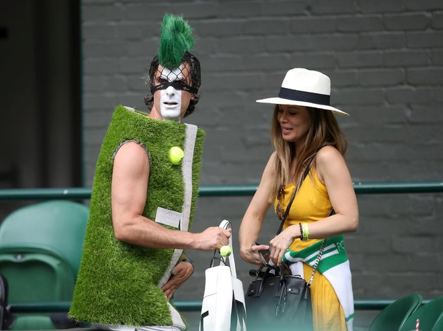 Spectators in fancy dress during Day 7 of The Championships – Wimbledon 2019 at the All England Lawn Tennis and Croquet Club on July 8, 2019 in London, England. (Photo by Carl Recine/Reuters)