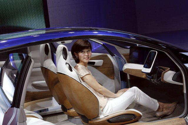 A woman sites inside the Nissan IDS concept car during the Auto China 2016 auto show in Beijing April 25, 2016. (Photo by Kim Kyung-Hoon/Reuters)