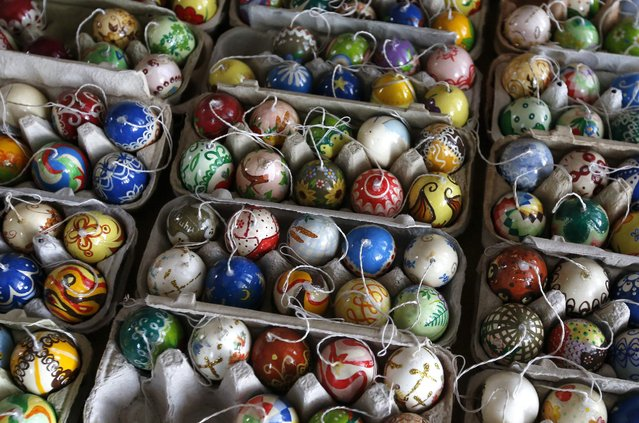 Part of the collection of Easter eggs of German pensioners Christa and Volker Kraft are displayed before they decorate an apple tree with them at their summerhouse in the eastern German town of Saalfeld, March 19, 2014. (Photo by Fabrizio Bensch/Reuters)