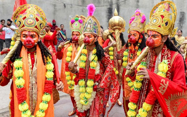 "Hindu devotees dressed as Hindu deity Lord Hanuman take part in a procession to mark the ""Navratri"" festival in Amritsar on October 5, 2019, ahead of the ""Dussehra"" festival. The festival of ""Dussehra"" is held on the last day of the ""Navratri"" festival, symbolising the triumph of good over evil, culminating when firecracker-stuffed effigies of the demon king are set alight. (Photo by Narinder Nanu/AFP Photo)"
