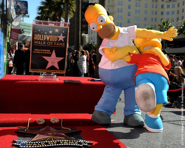 Homer and Bart Simpson attend the ceremony honoring Matt Groening with a Star on The Hollywood Walk of Fameon