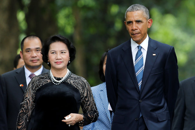 U.S. President Barack Obama walks with Vietnam's National Assembly Chairwoman Nguyen Thi Kim Ngan during a visit at the gardens of the presidential palace in Hanoi, Vietnam May 23, 2016. (Photo by Carlos Barria/Reuters)
