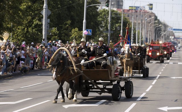 Belarussian firefighters take part in a parade of historic and modern fire equipment, during a celebration to mark their profession in central Minsk July 25, 2015. (Photo by Vasily Fedosenko/Reuters)