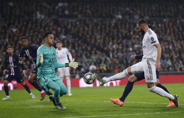 PSG's goalkeeper Keylor Navas, left, makes a save against Real Madrid's Karim Benzema during a Champions League soccer match Group A between Real Madrid and Paris Saint Germain at the Santiago Bernabeu stadium in Madrid, Spain, Tuesday, November 26, 2019. (Photo by Manu Fernandez/AP Photo)