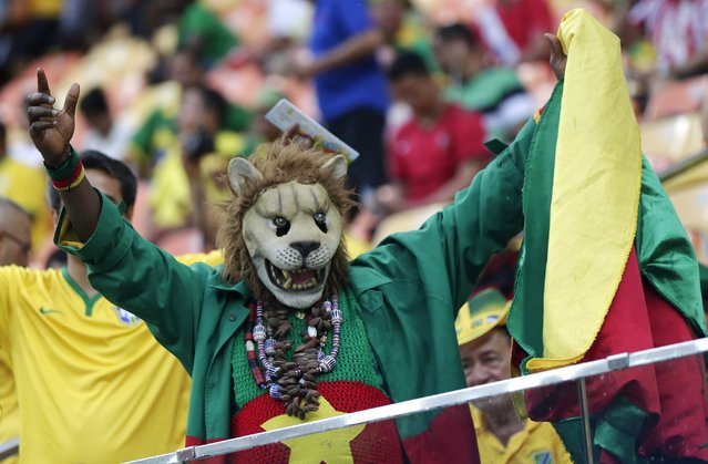 A Cameroon fan cheers before the group A World Cup soccer match between Cameroon and Croatia at the Arena da Amazonia in Manaus, Brazil, Wednesday, June 18, 2014. (Photo by Marcio Jose Sanchez/AP Photo)