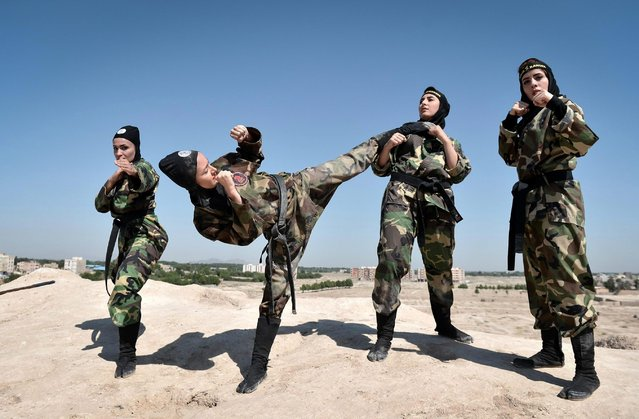 Iranian women perform as they train Far East Fighting Arts to be able to defend themselves, at the Jughin castle which is located 40 km's far from Tehran, Iran on June 5, 2017. (Photo by Fatemeh Bahrami/Anadolu Agency/Getty Images)