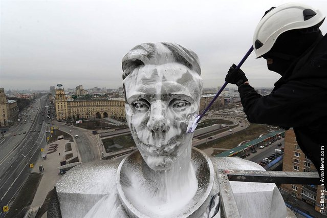 A municipal worker washes the upper part of the 230-foot-high monument to Yuri Gagarin, the first man in space, at Gagarin Square in Moscow, April 11, 2012. Russia celebrated Aviation and Cosmonautics Day, the anniversary of Gagarin making the first manned space flight in 1961