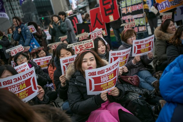 South Korean women protest against gender inequality and sexual harrassment in the workplace by participating in a march on March 8, 2017 in Seoul, South Korea. March 8, 2017 marks International Women's Day with events, protests and activites taking place around the world. (Photo by Jean Chung/Getty Images)