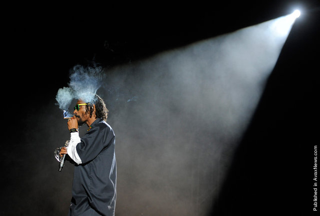 Snoop Dogg smokes onstage during his headlining performance with Dr. Dre on the first weekend of Coachella 2012, on April 15, 2012