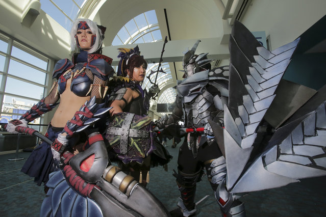 Characters from the Monster Hunter video game show off their monster hunting weapons during Comic-Con 2017 in San Diego, California, July 22, 2017. (Photo by Bill Wechter/AFP Photo)