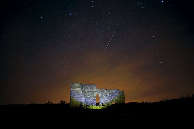 Meteors streak across the sky over a Roman theatre in the ruins of Acinipio, during the Perseid meteor shower near Ronda, southern Spain, in the early morning of August 13, 2015. The annual Perseid meteor shower reaches its peak on August 12 and 13 in Europe, according to NASA. (Photo by Jon Nazca/Reuters)