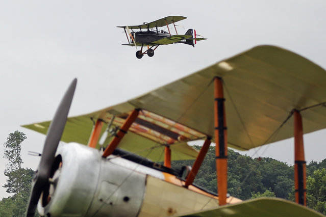 """The SE5a takes part in demonstration flight at """"The Shuttlesworth Collection"""" at Old Warden on July 21, 2014 in Biggleswade, England. Of the 55,000 planes that were manufactured by the Royal Army Corps (RAC) during WWI, only around 20 remain in airworthy condition. (Photo by Dan Kitwood/Getty Images)"""