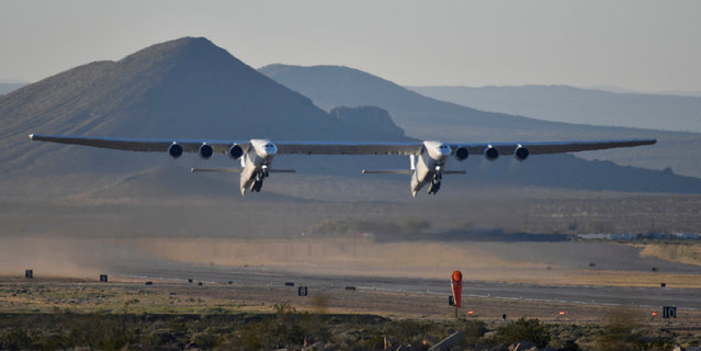 The world's largest airplane, built by the late Paul Allen's company Stratolaunch Systems, takes off on its first test flight in Mojave, California, U.S. April 13, 2019. (Photo by Gene Blevins/Reuters)