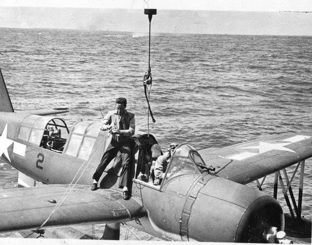 Lt. (jg) H.K.Anderson brings plane aboard after observation flight