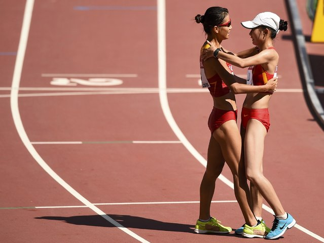 Liu Hong of China (L) celebrates with Lu Xiuzhi of China after winning the women's 20 km race walk final during the 15th IAAF World Championships at the National Stadium in Beijing, China August 28, 2015. (Photo by Dylan Martinez/Reuters)
