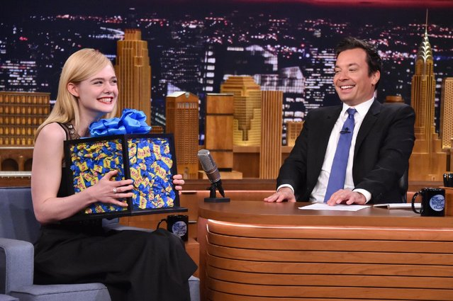 "Actress Elle Fanning (L) receives a large box of bubble gum from host Jimmy Fallon as she visits ""The Tonight Show Starring Jimmy Fallon"" at Rockefeller Center on June 22, 2016 in New York City. (Photo by Mike Coppola/Getty Images for NBC)"