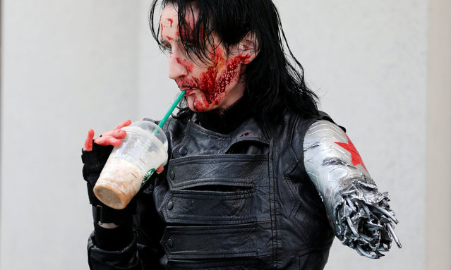 Dawn Richardson grabs a Starbucks drink in the costume of the Winter Soldier at the pop culture event Comic-Con International in San Diego, California, United States July 22, 2016. (Photo by Mike Blake/Reuters)