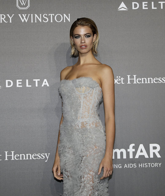 Hailey Clauson poses for photographers as she arrives for the amfAR charity dinner during the fashion week in Milan, Italy, Thursday, September 21, 2017. (Photo by Antonio Calanni/AP Photo)