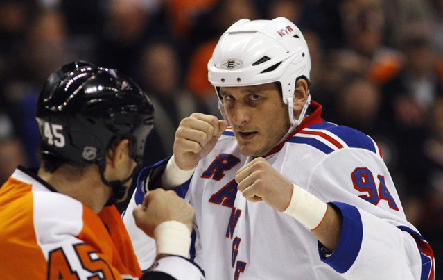 In this November 4, 2010, file photo, Philadelphia Flyers' Jody Shelley, left, and New York Rangers' Derek Boogaard fight during an NHL hockey game in Philadelphia. A former minor league hockey player has been arrested on charges he sold illegally obtained prescription painkillers to former hockey player Derek Boogaard of the Rangers and the Minnesota Wild who died of an accidental overdose. (Photo by Matt Slocum/AP Photo)