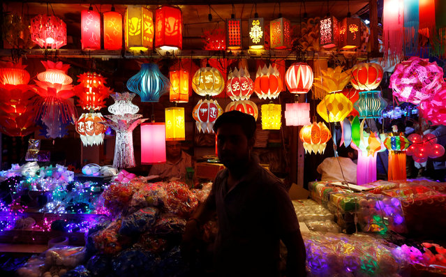 A vendor waits for customers at his shop of lanterns at a market on the eve of the Hindu festival of Diwali in New Delhi, October 18, 2017. (Photo by Adnan Abidi/Reuters)